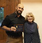 Nate Bowersock receives the 2018 Jack Creek Preserve Foundation Wildlife Scholarship from Dottie Fossel.