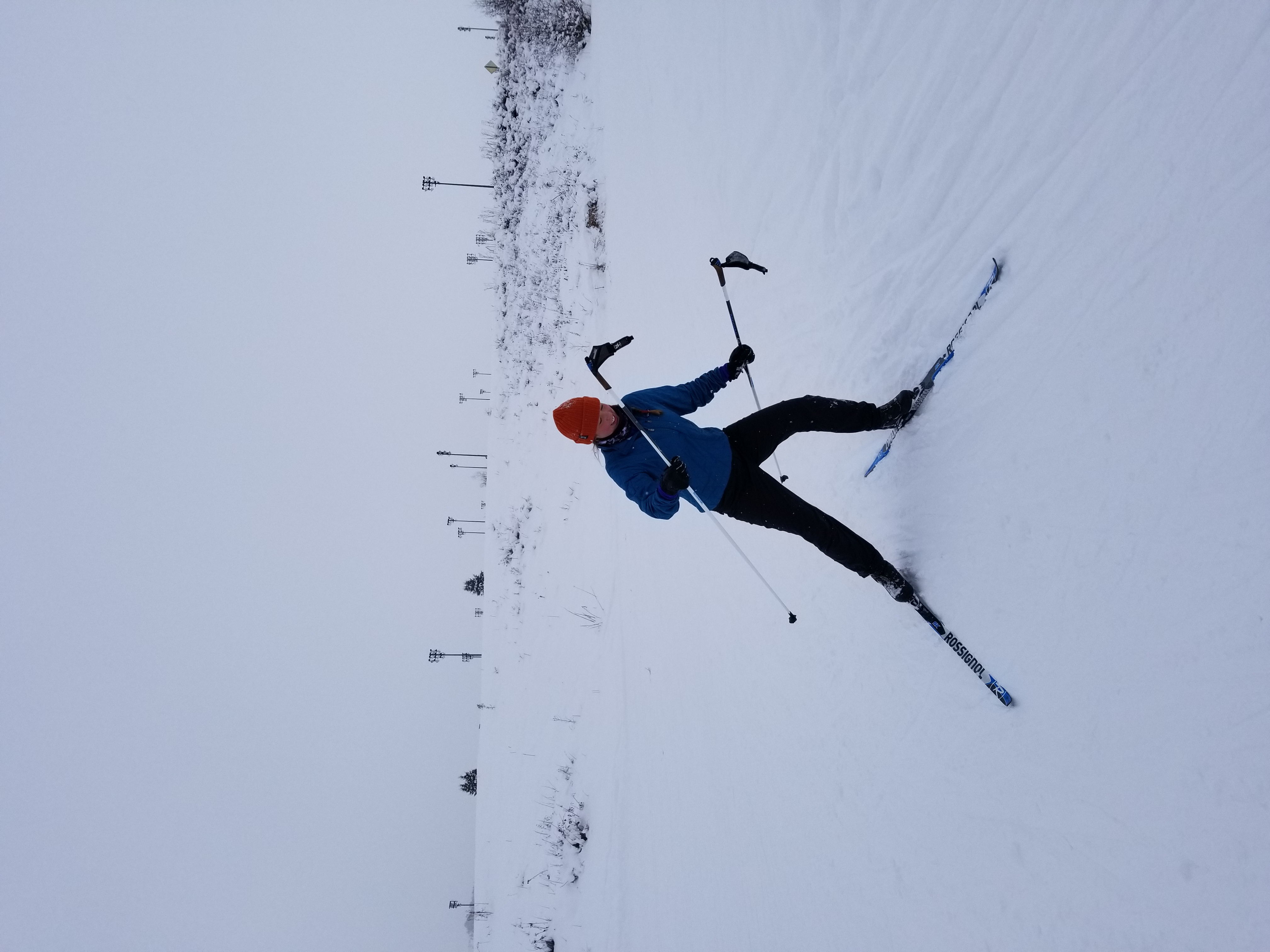 person cross country skiing with white snow all around