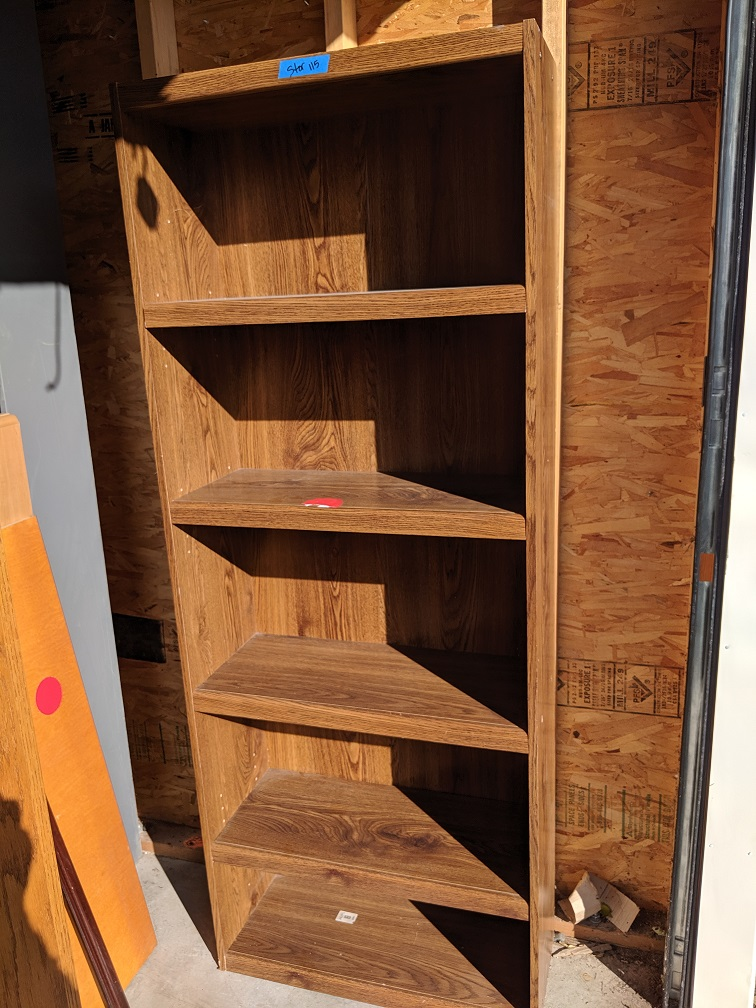 Brown particle board bookcase with 4 shelves