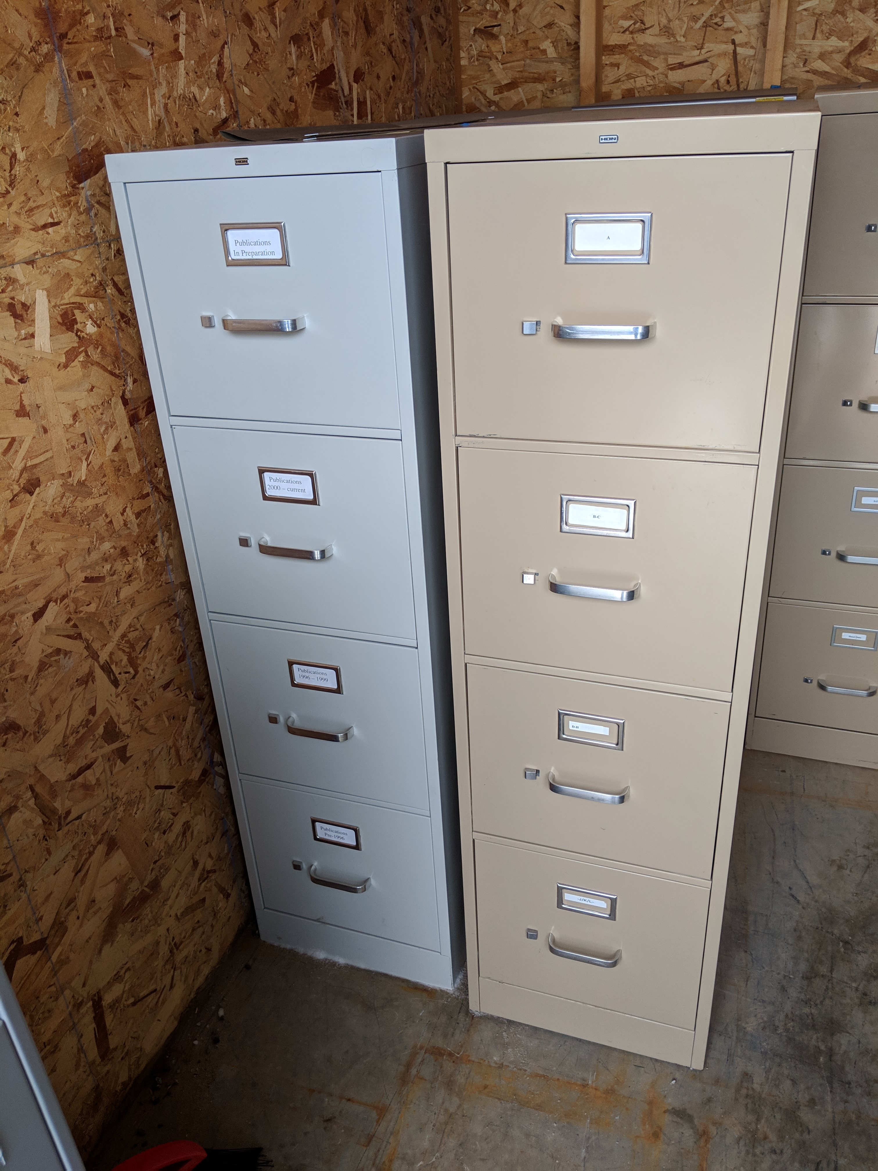 one grey and one tag four drawer file cabinet