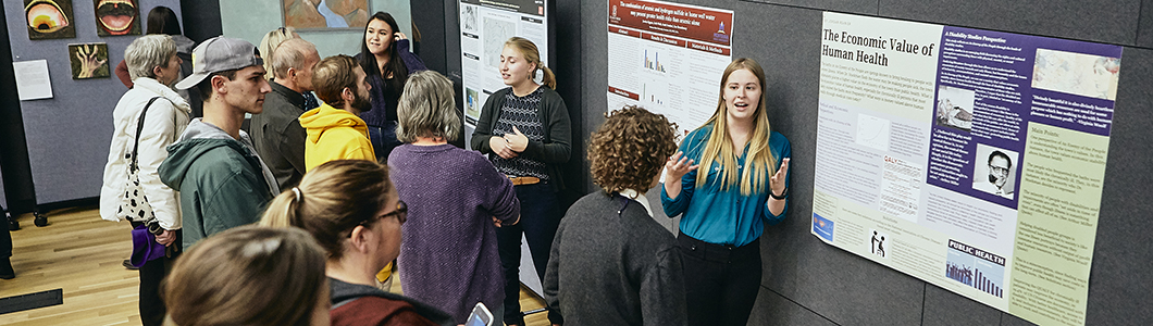 Students view a poster presentation