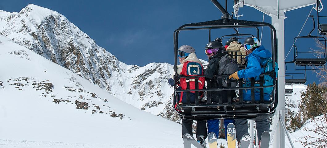 Students ride a chairlift at Big sky.