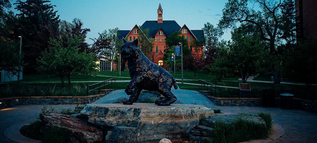 Statue of Spirit the Bobcat at twilight