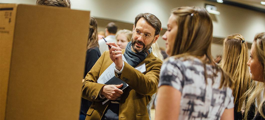 A faculty member discusses a student's research project.