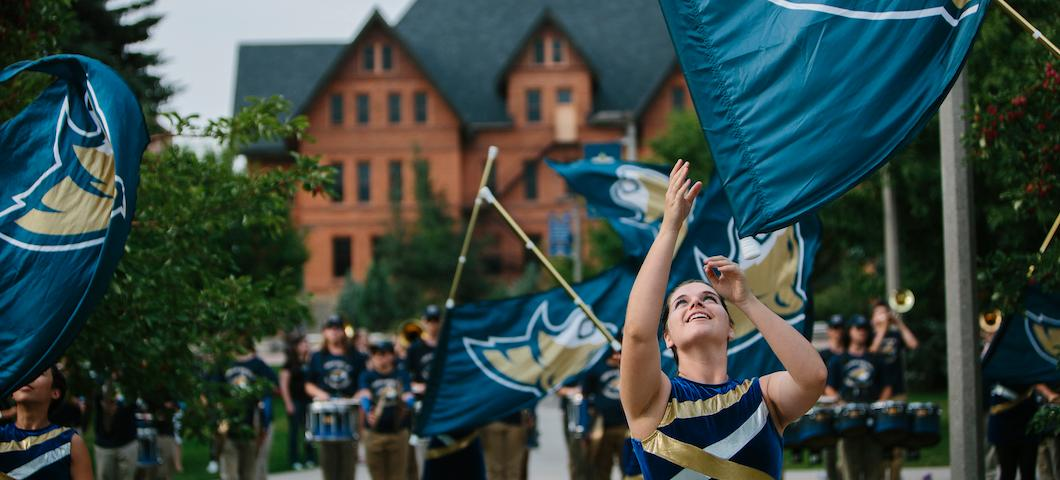 The Montana State Color Guard celebrates MSU Debut outside Montana Hall