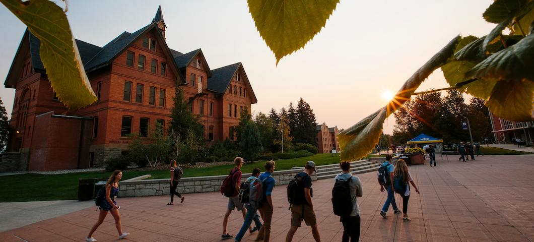 Students walk by Montana Hall on Centennial Mall early in the morning