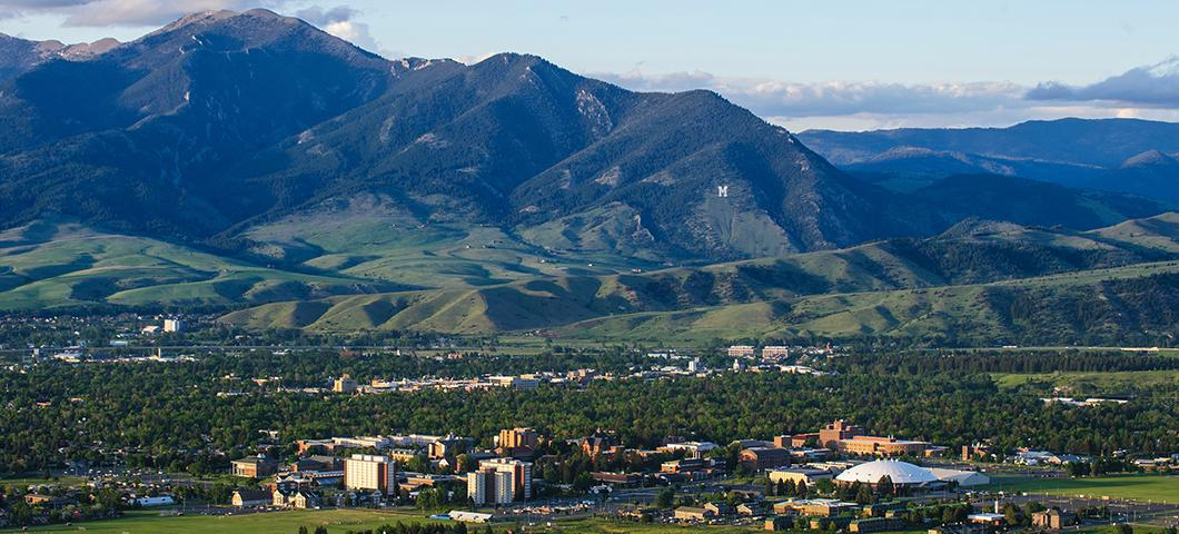 Aerial view of Bozeman with campus in the foreground and the Bridger mountains in the background.