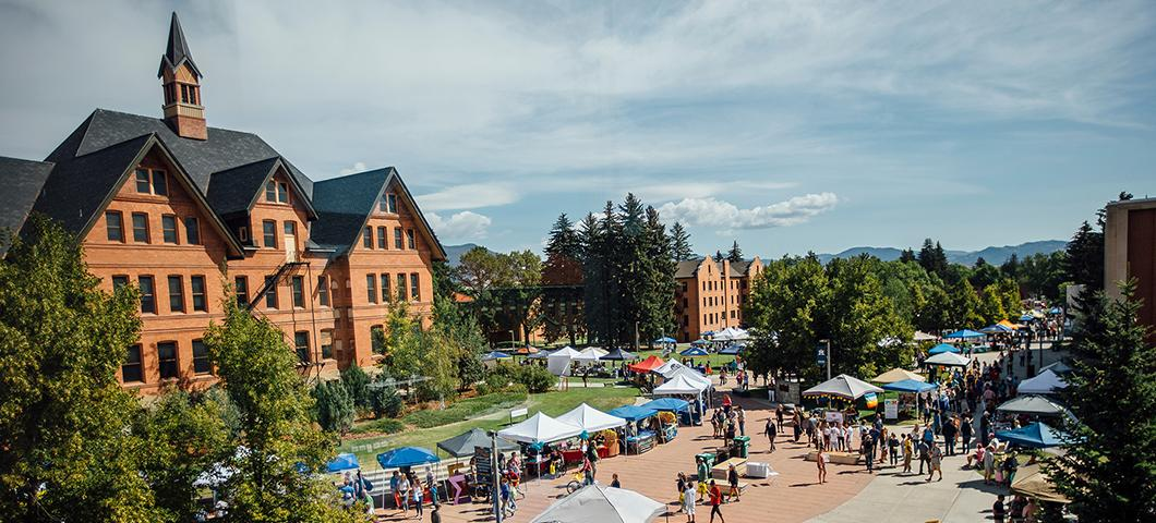 Catapolooza festival with tables and tents in front of Montana Hall during summer.