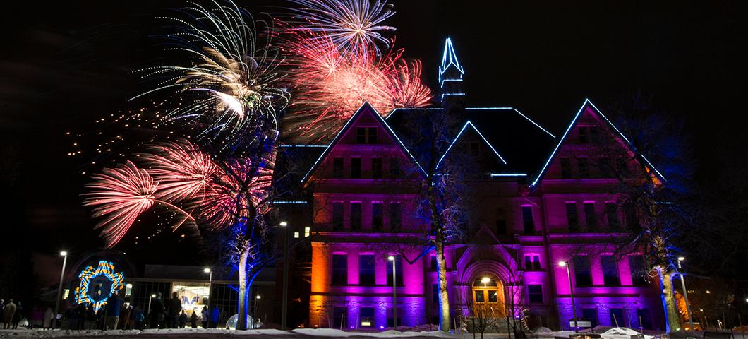 Fireworks over Montana Hall in the winter.