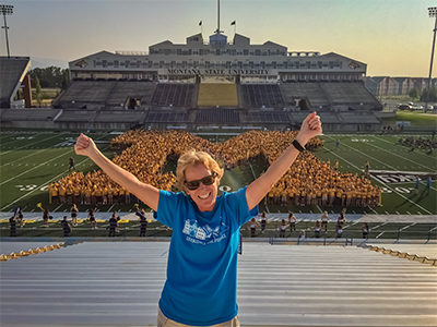 Ronda Russell stands in front of the new class at Bobcat Stadium.