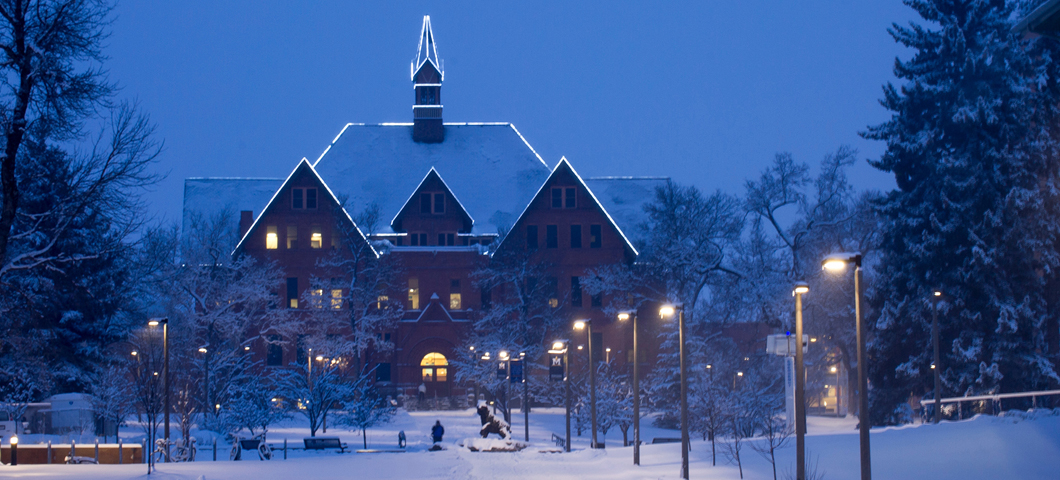 Montana Hall in the snow during winter.