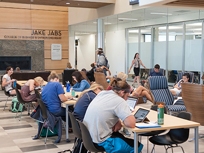 Students study around a table in Jabs Hall