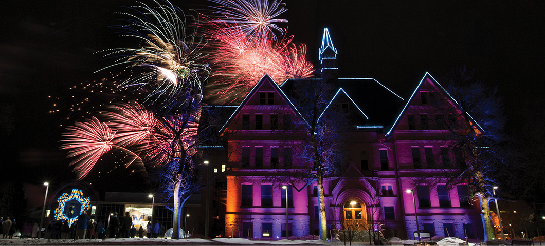 Fireworks behind Montana Hall during the 125th anniversary celebration.