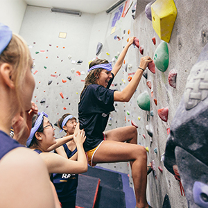 Students using the climbing wall in the fitness center