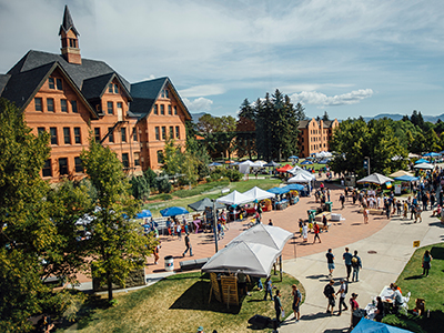 View of campus during the club fair in summer.
