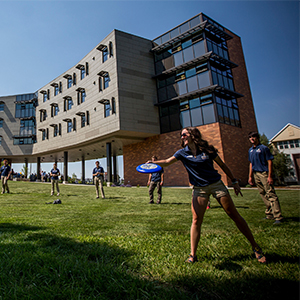 Students playing frisbee in front of Yellowstone Hall