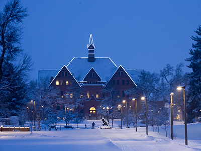 Montana Hall at night in winter.
