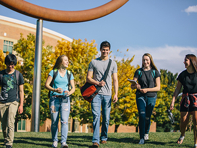 Students work on campus in a group.