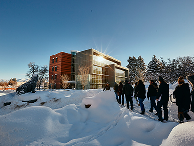 A tour crosses campus in winter.