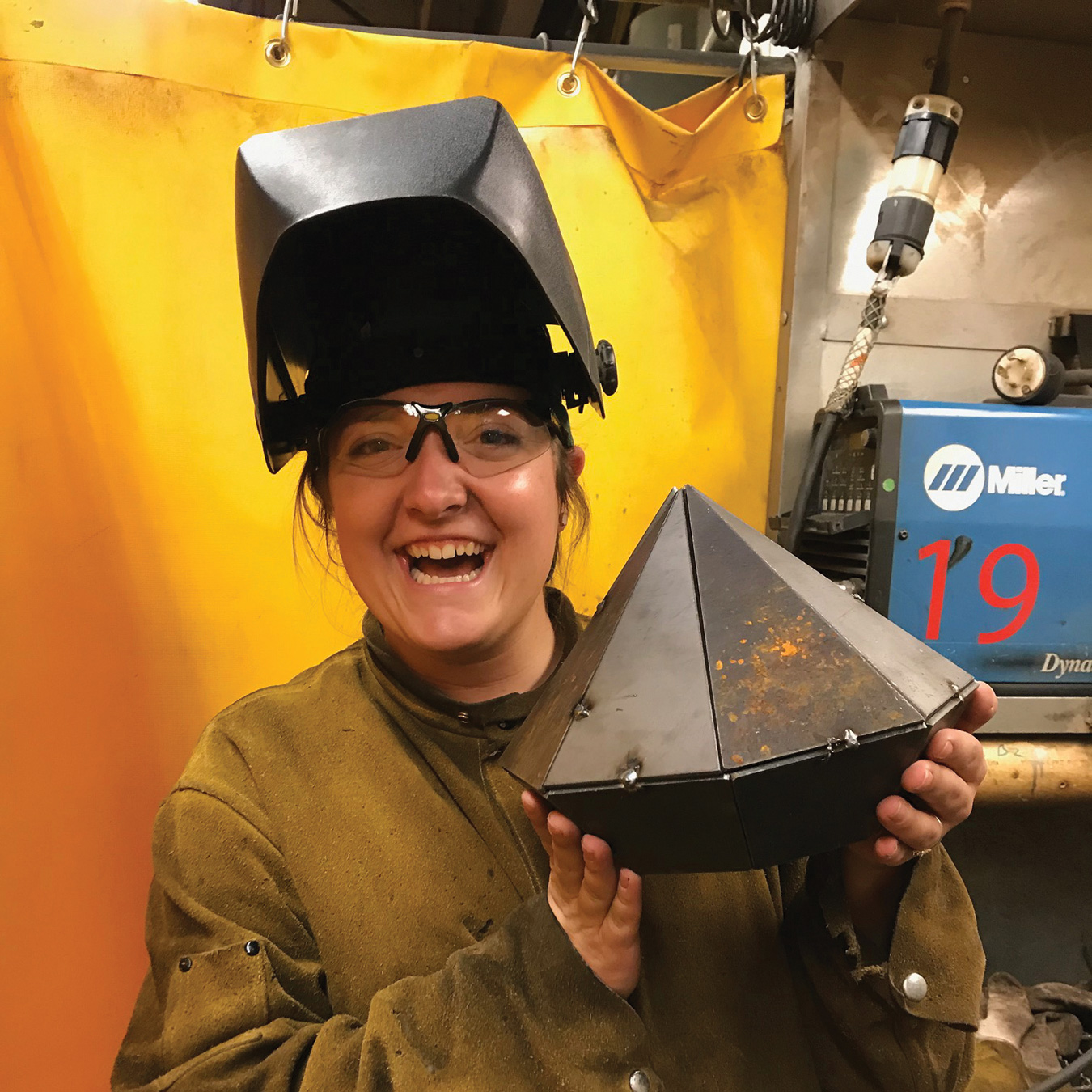 Portrait of Lauren in a welder's helmet