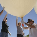 Montana State University students with the Eclipse Ballooning Project prepare high-altitude balloons for a test launch Wednesday, June 21 near Rexburg, Idaho. MSU photo by Kelly Gorham
