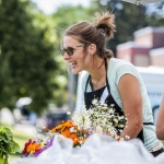 Allison Milodragovich, center, a Montana State University graduate student in community health, helps a customer at Towne's Harvest Garden food stand outside the Strand Union Building on campus on Thursday, July 14, 2016, in Bozeman, Mont. The garden is celebrating its 10th anniversary, with all produce grown organically by MSU students.  MSU Photo by Adrian Sanchez-GonzalezMSU Photo by Adrian Sanchez-Gonzalez