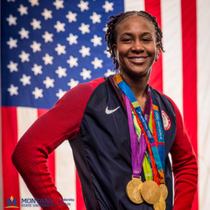 Tamika Catchings poses with four gold medals in front of the American flag. Photo courtesy of Tamika Catchings.