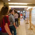 Attendees at the Maurice Hilleman Vaccine Symposium study posters illustrating research in the areas of microbiology and immunology Saturday, April 23, 2016 in Bozeman, Mont.MSU photo by Kelly Gorham