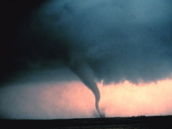 "Tornado with dust and debris cloud forming at surface in Cordell, OK, May 22, 1981. During ""Sound Chase"", a joint project of NSSL and Mississippi State University. Photo courtesy NOAA Photo Library, NOAA Central Library; OAR/ERL/National Severe St"