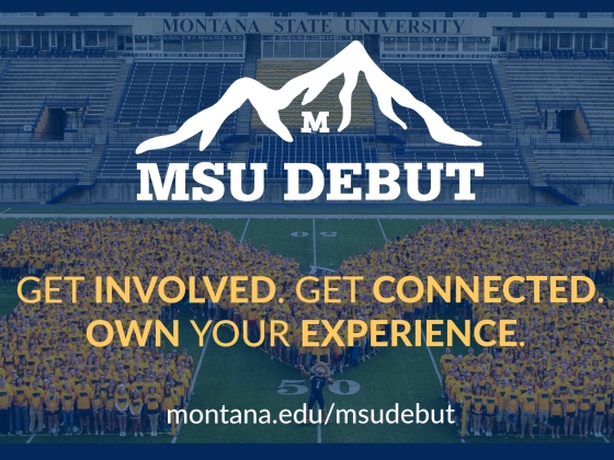 """Montana State University freshmen pose on the football field in the shape of a large """"M."""" 