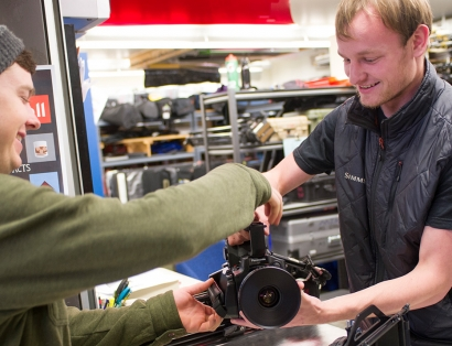 MSU Film student checks out equipment available through the university in the Visual Communications Building.