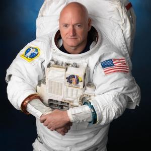Astronaut Captain Scott Kelly posing in his space suit.