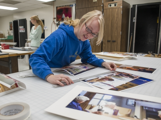 A film & photography student works on editing images.