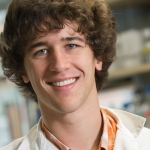 Montana State University student Josh Carter holds a model of a protein structure in the Blake Wiedenheft laboratory.