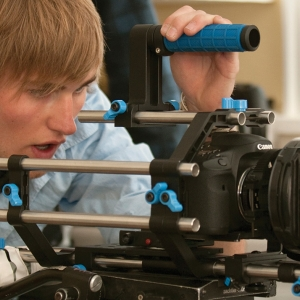An MSU Film student uses a camera to shoot a film as part of a project.