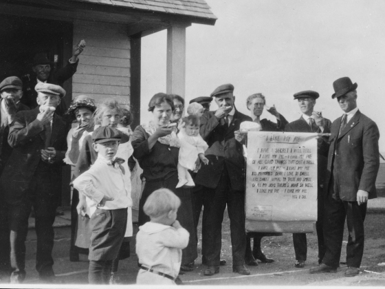 A black and white photo from 1923 of a group of people outside a building holding pies. | Montana Historical Society Research Center Photograph Archives, Helena, MT