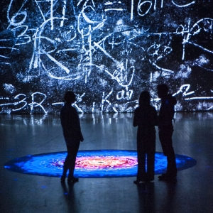 Visitors to the Black (W)hole traveling exhibit are enveloped by a multimedia experience.