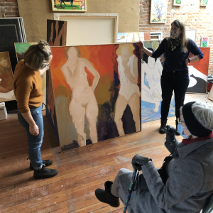 Graduate students working with local art collections
