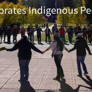 A large circle of people arrange themselves for a round dance on the Malone Centennial Mall at Montana State University.
