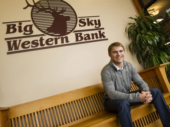 Montana State University business student Tevan Rembe in Big Sky Western Bank lobby. | MSU photo by Kelly Gorham