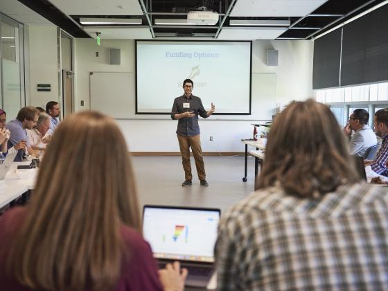 Man presenting to a group of people in a classroom. | MSU photo by Kelly Gorham