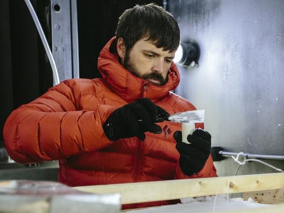 Kevin Hammonds, wearing orange down jacket, takes a snow sample in the Subzero Lab  