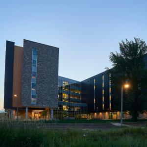 Evening exterior photo of the Hyalite Hall East courtyard