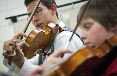 A student plays violin