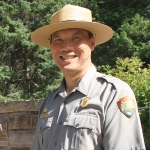 A photo of Jeff Mow who is dressed in a National Park Ranger university and a ranger wide-brimmed hat.