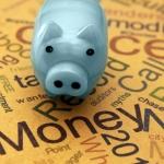 Piggy bank and money text