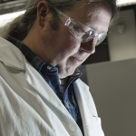 Eric Boyd, assistant professor of environmental microbiology and associate director of the Thermal Biology Institute at Montana State University, works in the Boyd Lab on Friday, Feb. 10, 2017, in Bozeman, Montana. Boyd is co-author of a 25-year retrospective about the search for life deep in Earth's crust. The paper was published July 3 in the scientific journal PNAS.  MSU Photo by Kelly Gorham