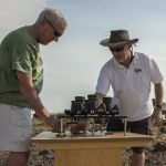 Montana State University engineering professor Joe Shaw, right, and father Glenn set up an instrument to measure polarization before the August total solar eclipse.
