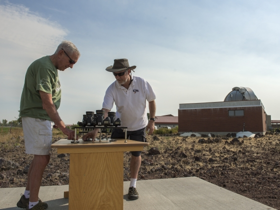 Montana State University engineering professor Joe Shaw, right, and father Glenn set up an instrument to measure polarization before the August total solar eclipse. | MSU photo by Kelly Gorham