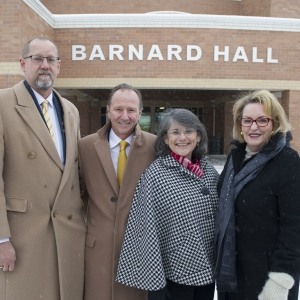 Photo of Montana State University College of Engineering Dean Brett Gunnink, Tim Barnard MSU President Waded Cruzado and Mary Barnard in front of Barnard Hall.